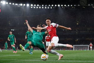 Ozil attempts to cut one into the area.