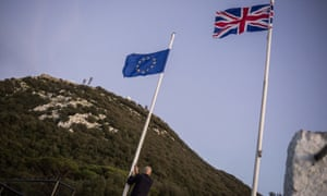 A worker lowering the EU flag in Gibraltar as the UK leaves the bloc.