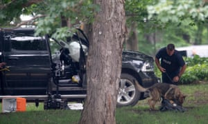 A police officer works with a police dog as they move through the contents of a pickup truck on the grounds of Rideau Hall in Ottawa.