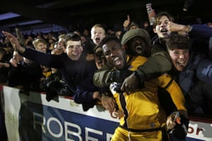 Sutton's Bradley Hudson-Odoi celebrates with fans after their FA Cup third round replay 3-1 victory at The Cherry Red Records Stadium.