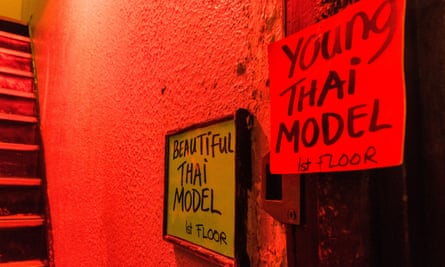 Advertisements for prostitutes in a Soho doorway