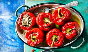 Bell peppers stuffed with rice, raisins and pine nuts.