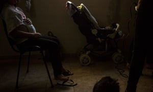 A pregnant 11-year-old sits during a hairdressing class in the Casa Rosa María children's shelter.