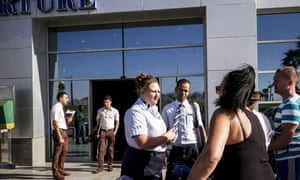 Representatives of a travel firm talk to tourists stranded at the airport in Sharm el-Sheikh, Egypt, on Thursday.