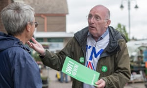 A remain campaign volunteer talks to a member of the public in Caldicot, Wales