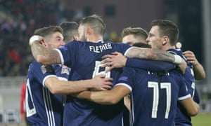 Scotland's players celebrate James Forrest's second goal and their fourth against Albania.
