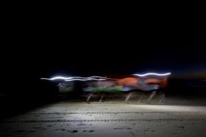 Lisbon, PortugalParticipants take part in the night race at Costa da Caparica near Lisbon.