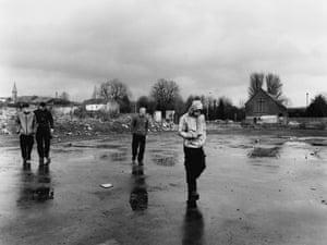 Shankill: boys passing wasteland on Lanark Way, 2017