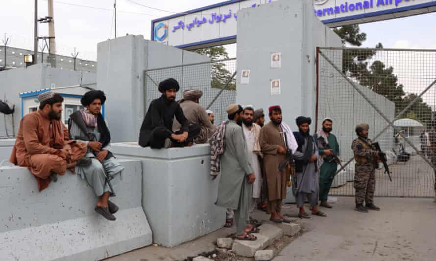 Taliban fighters stand guard outside Hamid Karzai international airport in Kabul on Wednesday