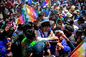 Morales is greeted by supporters on the road between Uyuni and Oruro, after his return from Argentina