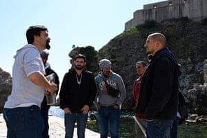 A guide conducts a Game of Thrones tour with fans from Spain under the Lovrijenac fort