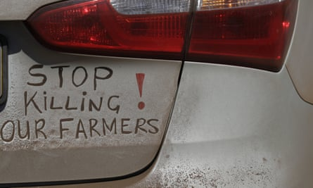 A bumper sign calls for the end of farm killings in South Africa, during a blockade of a freeway in Midvaal, South Africa.