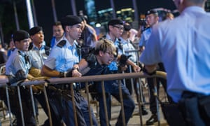 An activist is detained in recent protests in Hong Kong: the new law is alarming groups fearing a crackdown as Beijing exerts its control.