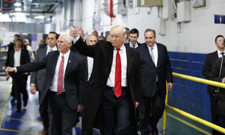 Donald Trump and Mike Pence at a Carrier factory in Indiana. The company has reversed its decision to outsource jobs to Mexico.