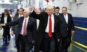 President-elect Donald Trump and Vice President-elect Mike Pence wave as they visit a Carrier factory in December 2016, in Indianapolis, Indiana.
