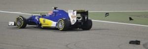 Sauber driver Felipe Nasr avoids debris on the track.