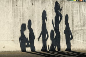 The shadows of competitors are seen during the women's marathon final.