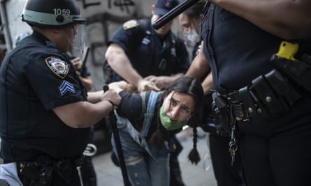 Police detain a protester during a rally for George Floyd  in New York.