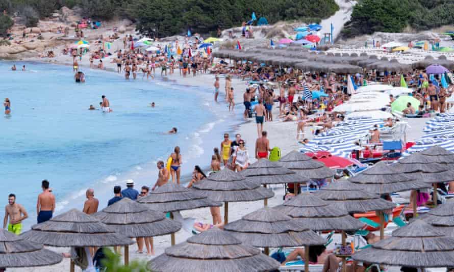 A crowded beach on the Emerald Coast