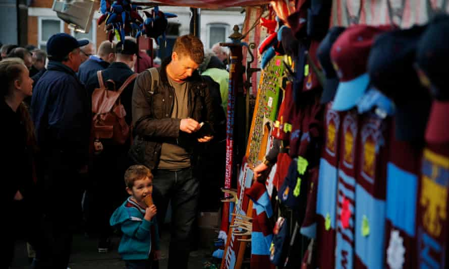 Supporters buying merchandise from stalls outside Upton Park. Many of the vendors are yet to be told if there will be a place for them outside the Olympic Stadium from next season.