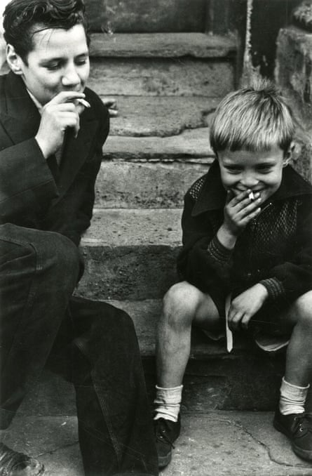 'Two lads share a cigarette and a joke' in Boys Smoking (1956)