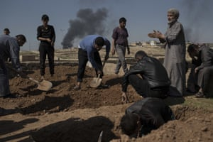 Relatives and friends bury the body of Khadeer Hassan who was killed during fighting in western Mosul between Iraqi security forces and Isis