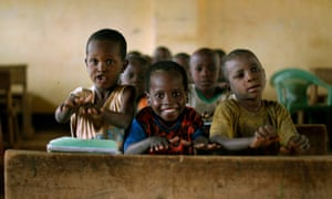 Somali children smile as they sing during class at the camp.
