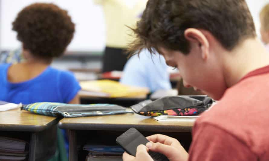 A pupil using a smartphone in the classroom.