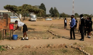 Students practice social distance in a queue for handwashing on 30 September 30, 2020 in Harare, Zimbabwe.