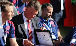 Louis van Gaal consults his notes during Manchester United's 3-2 victory against Southampton at St Mary's.