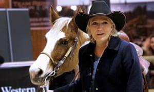 Marine Le Pen visits a horse show in Villepinte, Paris, in December.