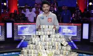 John Cynn poses for photographers after winning the World Series of Poker main event