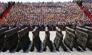 Soldiers of China's People's Liberation Army march during the military parade in Beijing.