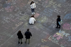 People write messages on the ground at Place de la Bourse