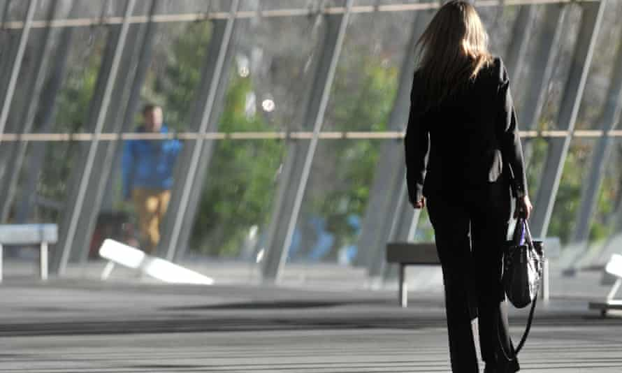A business woman is seen walking through the Melbourne Exhibition Centre in Melbourne