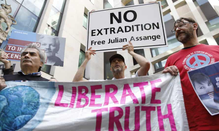 Supporters of Julian Assange protest outside London's Westminster magistrates court.