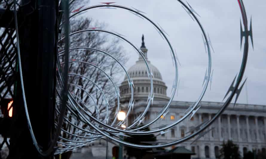 Razor wire is seen atop fencing outside the US Capitol building on 25 January.