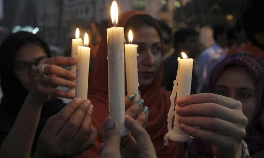 People attend a candlelight vigil for the victims of the Quetta attack in Lahore