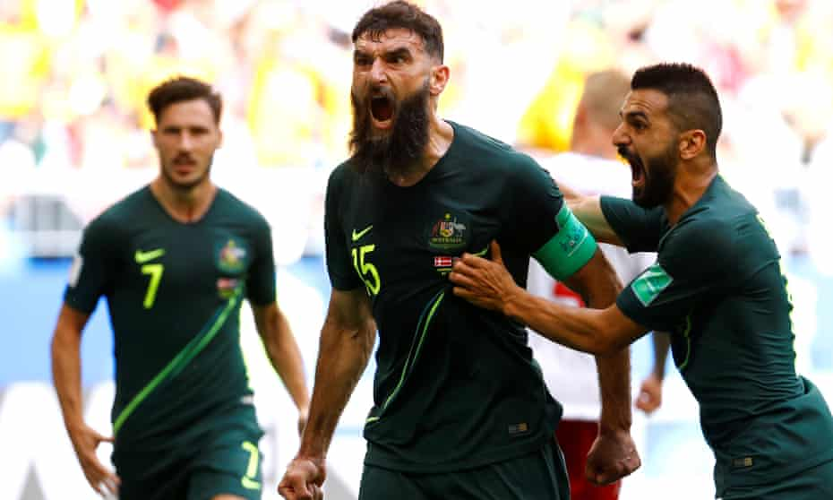 Australia's Mile Jedinak celebrates after scoring from the spot against Denmark