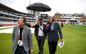 Test Match Special commentators Phil Tufnell, Michael Vaughan and Jonathan Agnew avoid the rain.