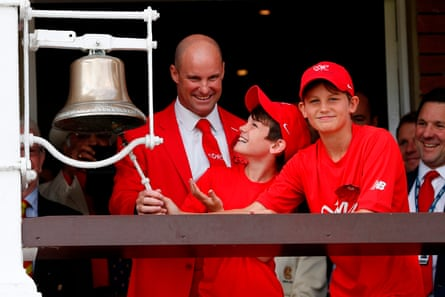 Strauss with Luca (left) and Sam dressed in red for the Ruth Strauss Foundation while ringing the five-minute bell during an Ashes Test at Lord's in 2019.