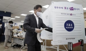 The South Korean president, Moon Jae-in, enters a voting booth in Seoul on 10 April.