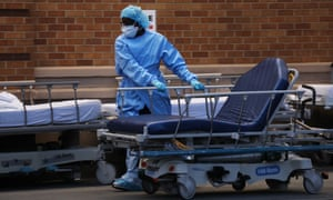 A medical worker prepares for patients at Maimonides medical center in Brooklyn, New York City