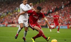 Aberdeen's Scott McKenna fends off Burnley's Matthew Lowton.