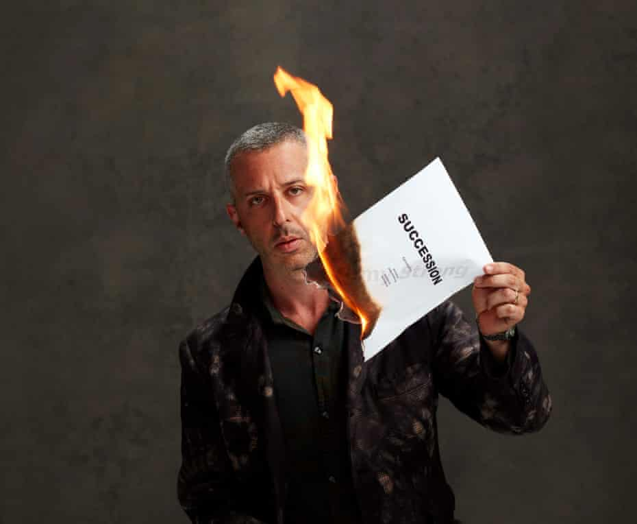 Jeremy Strong holding a burning page of the Succession script