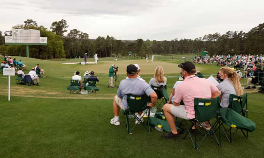 Spectators at the 18th green of the Masters, which stands alone as a tournament that denies the general use of mobile phones.