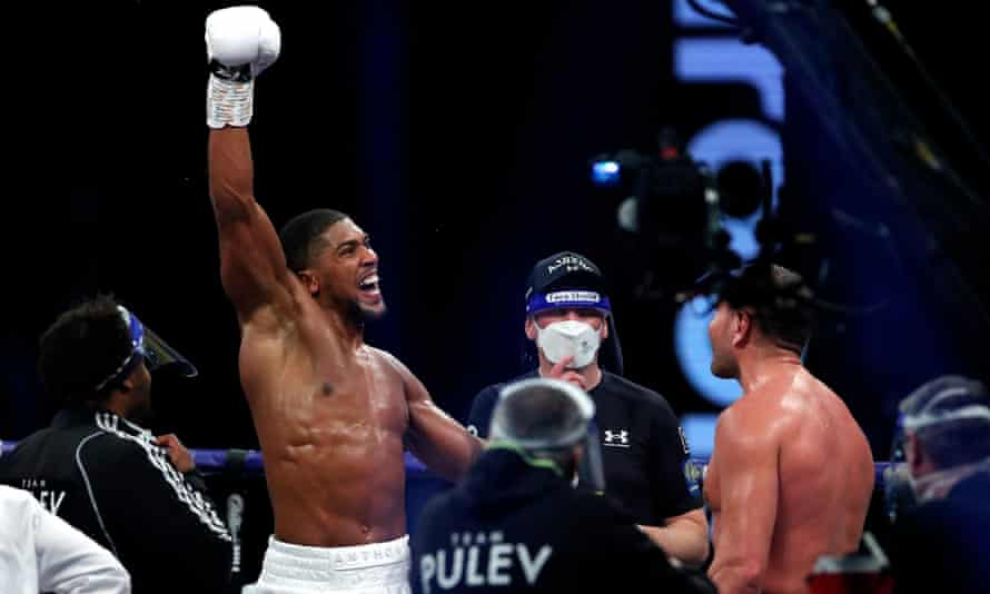 Anthony Joshua celebrates after being officially declared winner of his defence against Kubrat Pulev.