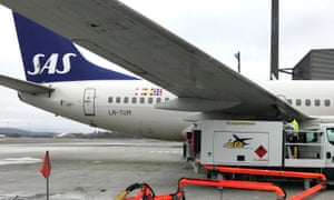 A Scandinavian Airlines plane is refuelled at an airport in Oslo, Norway.