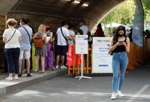 People queue at a testing site in Paris