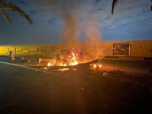 A burning vehicle at Baghdad airport following an airstrike.